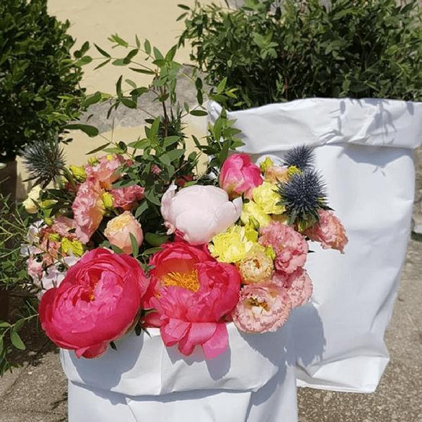 Allestimento matrimonio con peonia, lisianthus ed eryngium